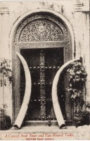 A carved arab Door & two record tusks