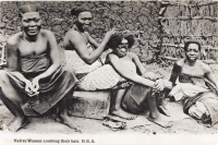 Native women combing their hair. B.E.A.