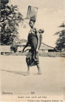 Swahili water carrier and baby.