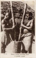 Kikuyu Women pounding maize in wooden mortar