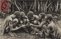 Akikuyu - Shepherd boys extracting a thorn from a lamb's foot