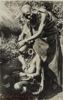 nil (a Kikuyu woman shaving another one)