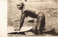 Kikuyu woman grinding grain