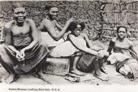 Native women combing their hair. B.E.A.