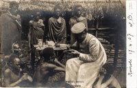 Missionary treating Akikuyu patients