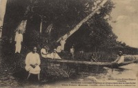Church Students boating in a hollowed tree