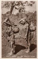 "A ""Kikuyu"" woman and girl carrying water. Kenya"