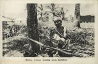 Native woman making mats