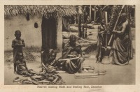 Natives Making Mats and beating Rice, Zanzibar