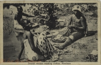 Swahili women washing clothes. Mombasa