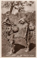 "A ""Kikuyu"" woman and girl carrying water. Kenya"