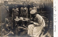 Missionary treating Akikuyu patients