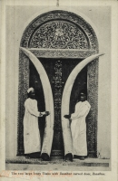 The two large Ivory Tusks with Zanzibar carved door