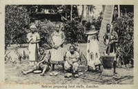 Natives preparing food stuffs