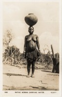 Native woman carrying water