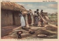 Donne Acioli che vagliano la dura (grano indigeno)
