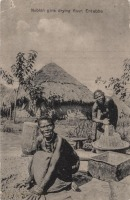 Nubian Girls drying flour, Entebbe
