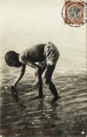 nil (young boy fishing)