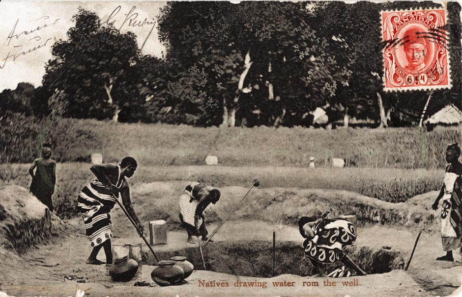 Natives drawing water from the well